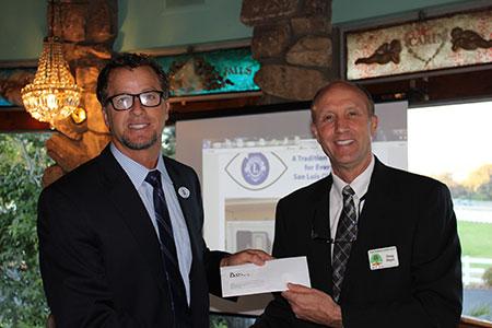 Dr. Derek Lauretzin (left) donates to Lions Clubs of SLO County